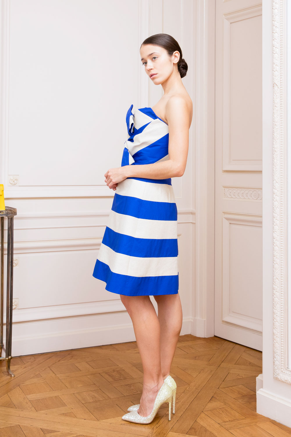 Blue and ivory striped bustier dress with Delpozo's signature oversized bow